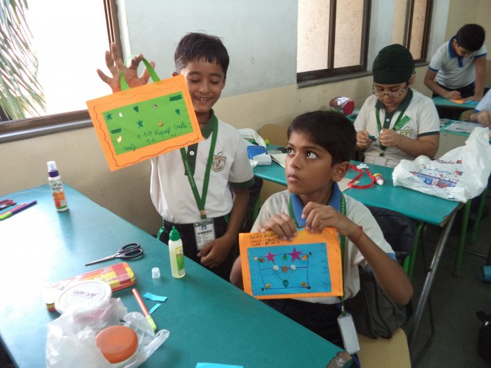 CLASS-IV PAPER BAG MAKING